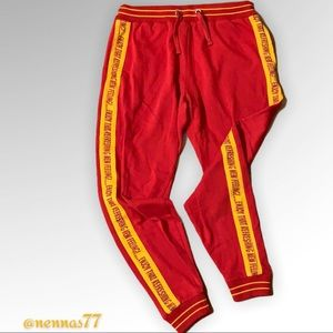 Coca-Cola red and gold joggers